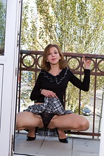 Darina's naughty little balcony strip down